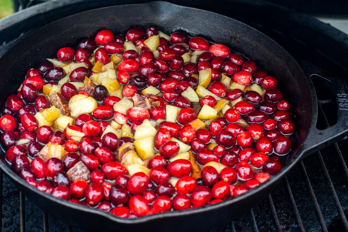 smoked apples and oranges in the cranberry mix in a cast iron skillet on the grill.