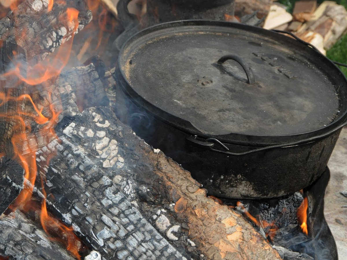 cast iron dutch oven right in the coals and fire at the campfire.