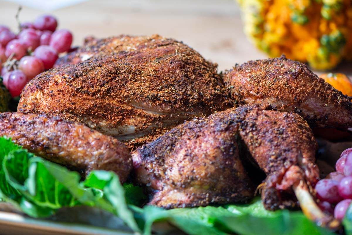 crispy butterflied turkey on a serving platter.