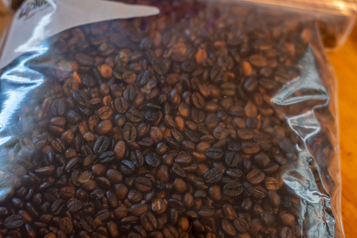 whole roasted and smoked coffee beans in a Ziploc Bag.