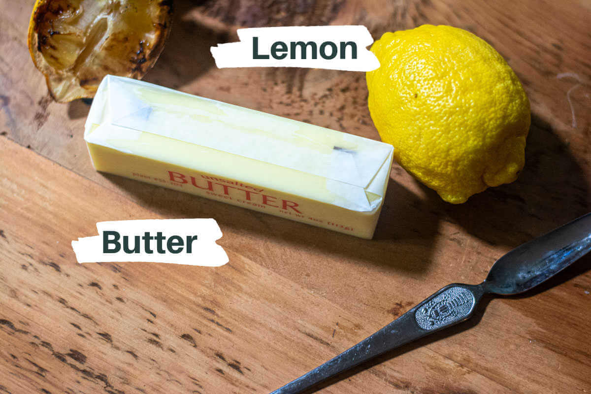 simple ingredients with labels for the charred lemon butter on the counter.