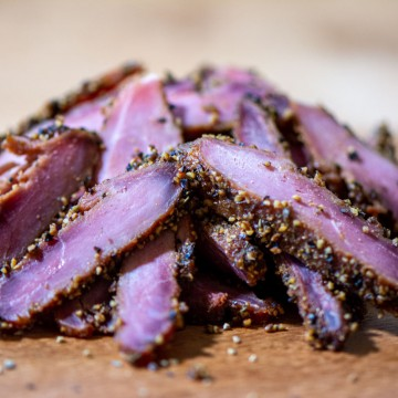 pile of cured and smoked goose breast with an insanely delicious crust.