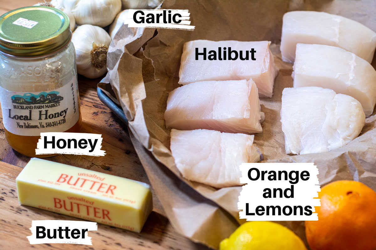 ingredients with labels for the grilled halibut on a wooden counter.
