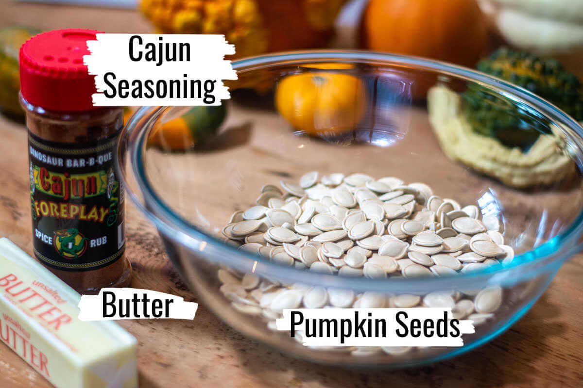 three ingredients with labels showing the seeds, butter and cajun seasoning.
