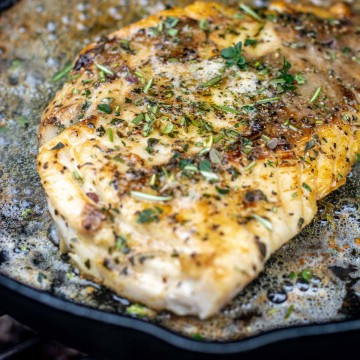 fillet of pacific rockfish topped with fresh herbs and brown butter.