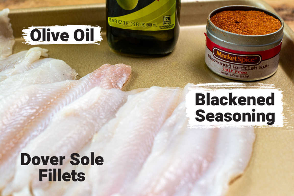 ingredient photo showing the skinned dover sole fillets, olive oil and blackened seasoning with labels.