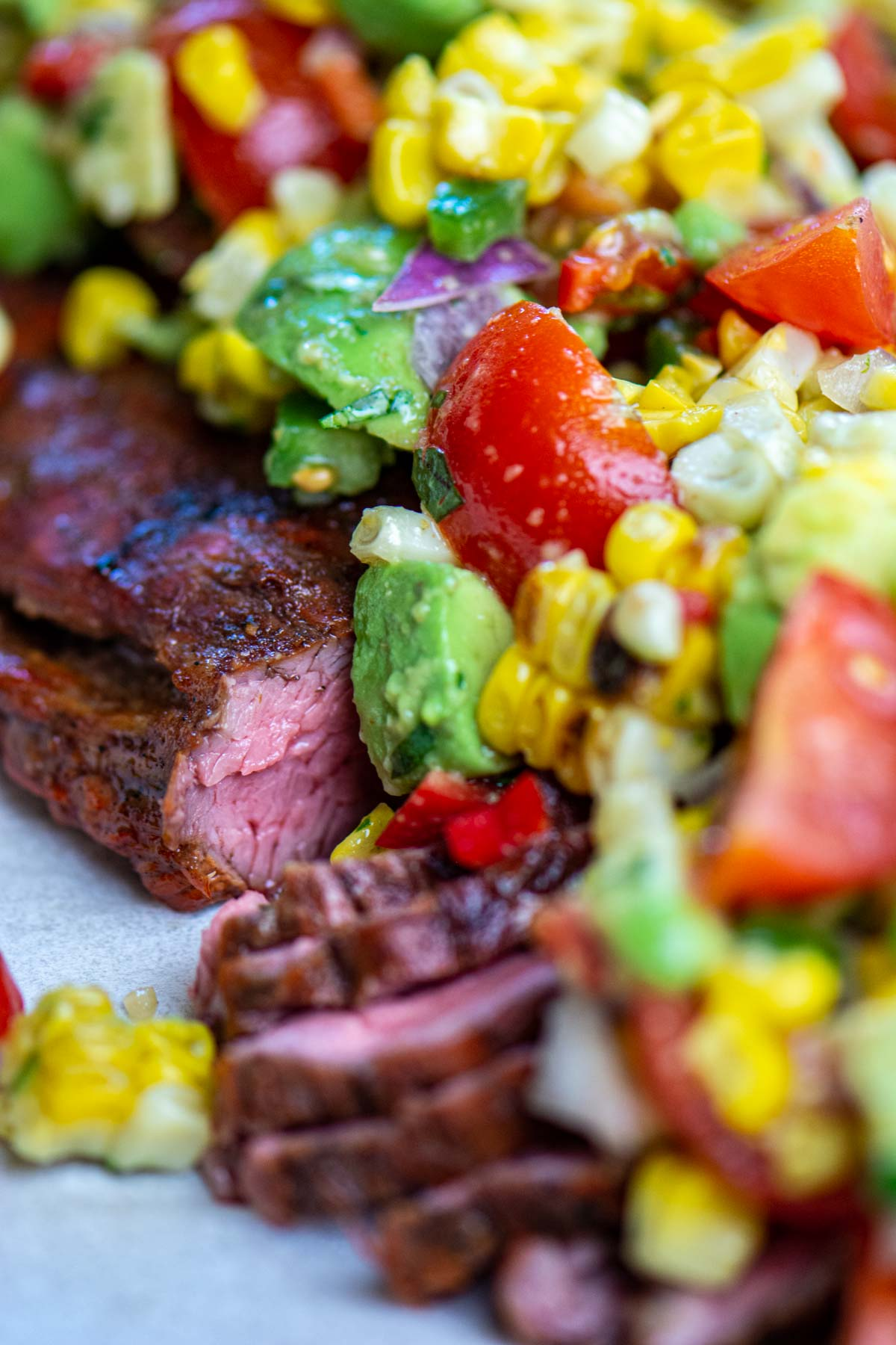 grilled and sliced flank steak topped with freshly chopped veggies.