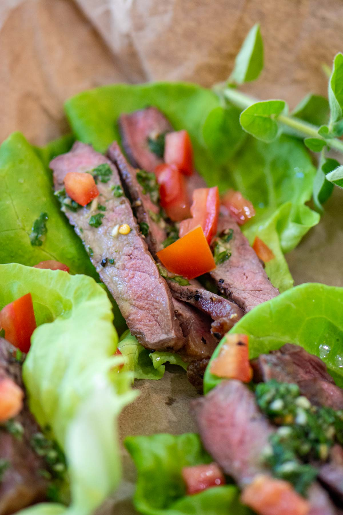 sliced grilled sirloin on lettuce wraps and topped with a fresh Chimichurri sauce.