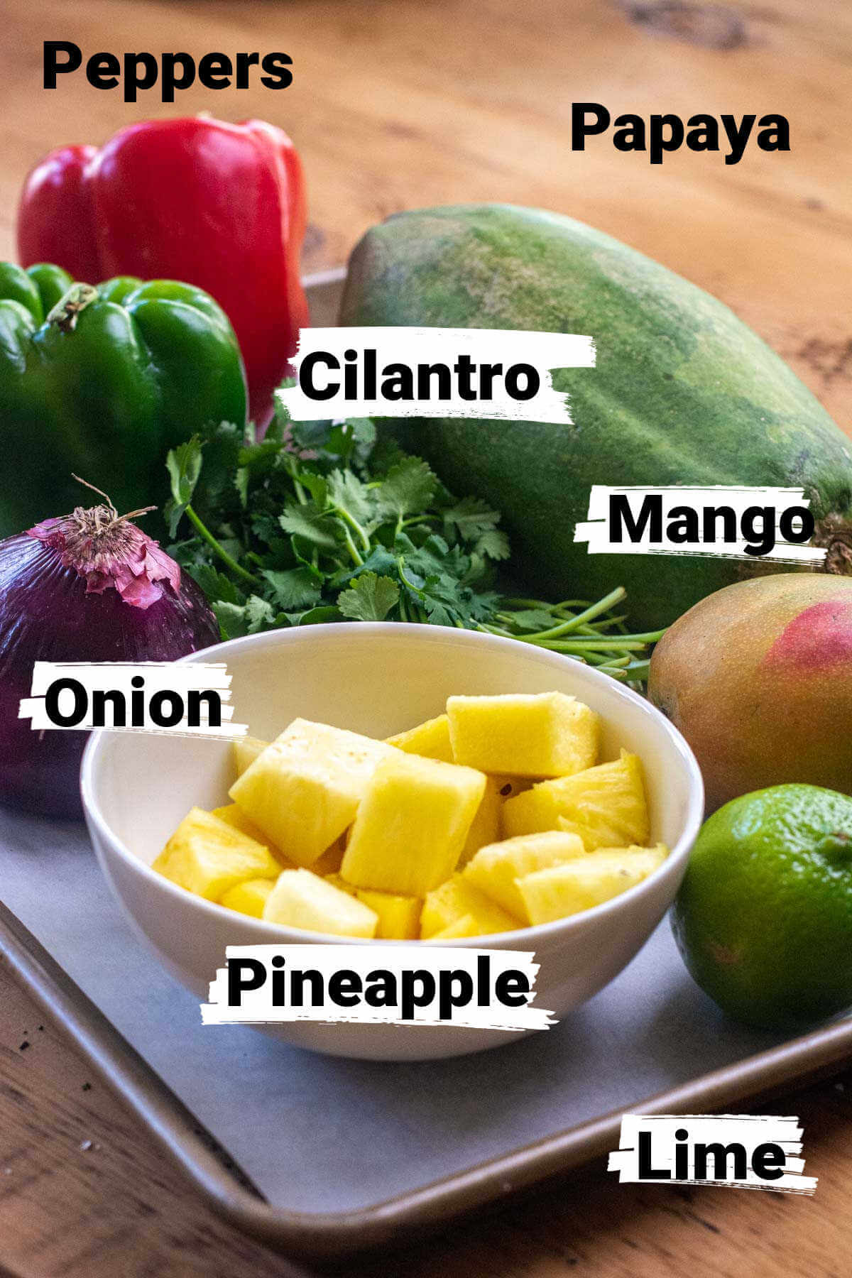 ingredient photo showing the fresh fruits on a sheet pan with labels.