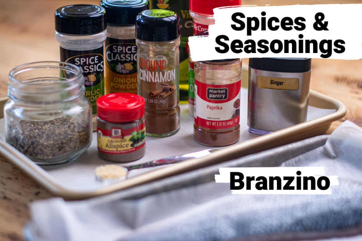 ingredients for the jerk seasoning on a sheet pan and the filets of Branzino with labels.