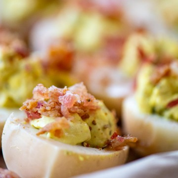 deviled egg and crumbled bacon on a sheet pan.