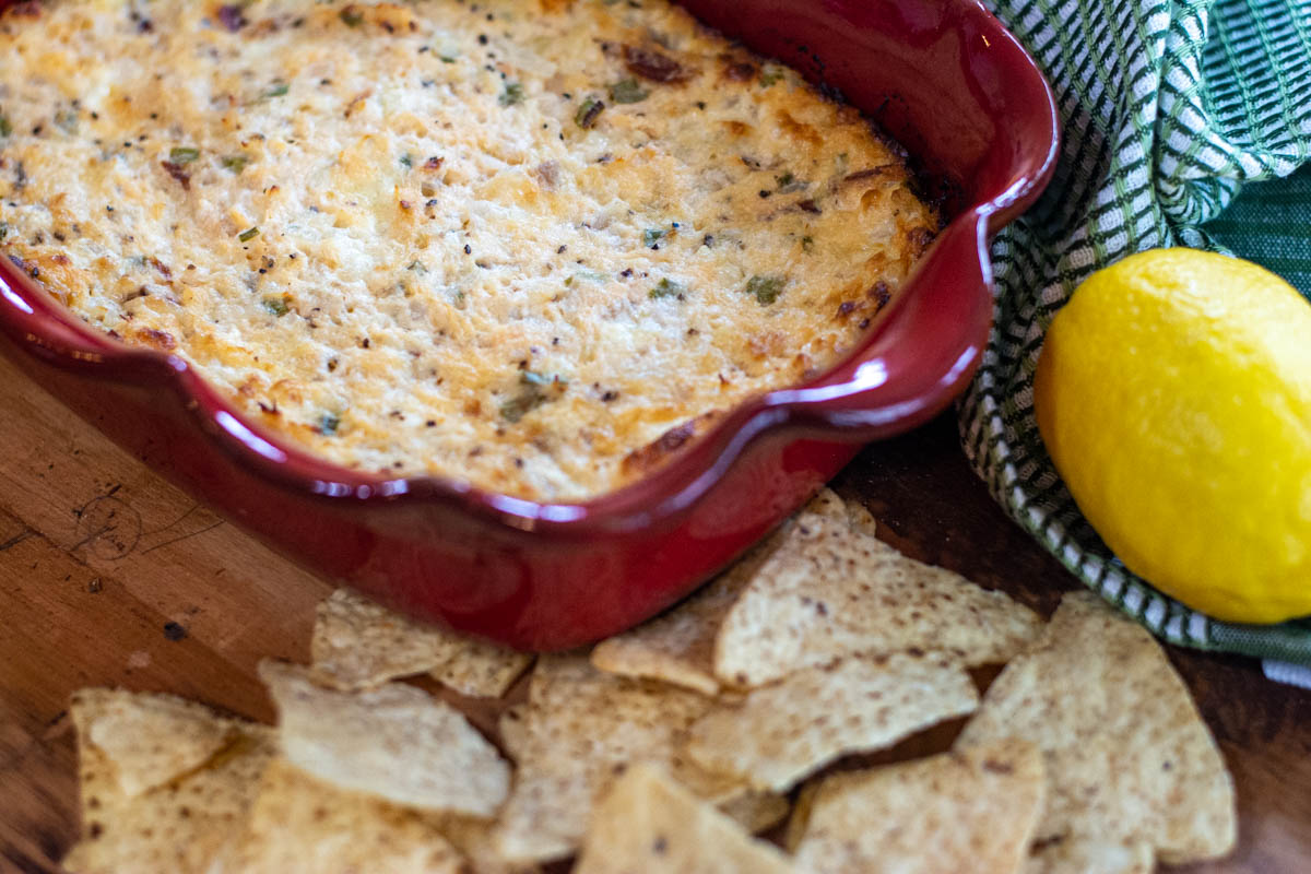 salmon dip after removed from the oven with freshly baked corn chips.