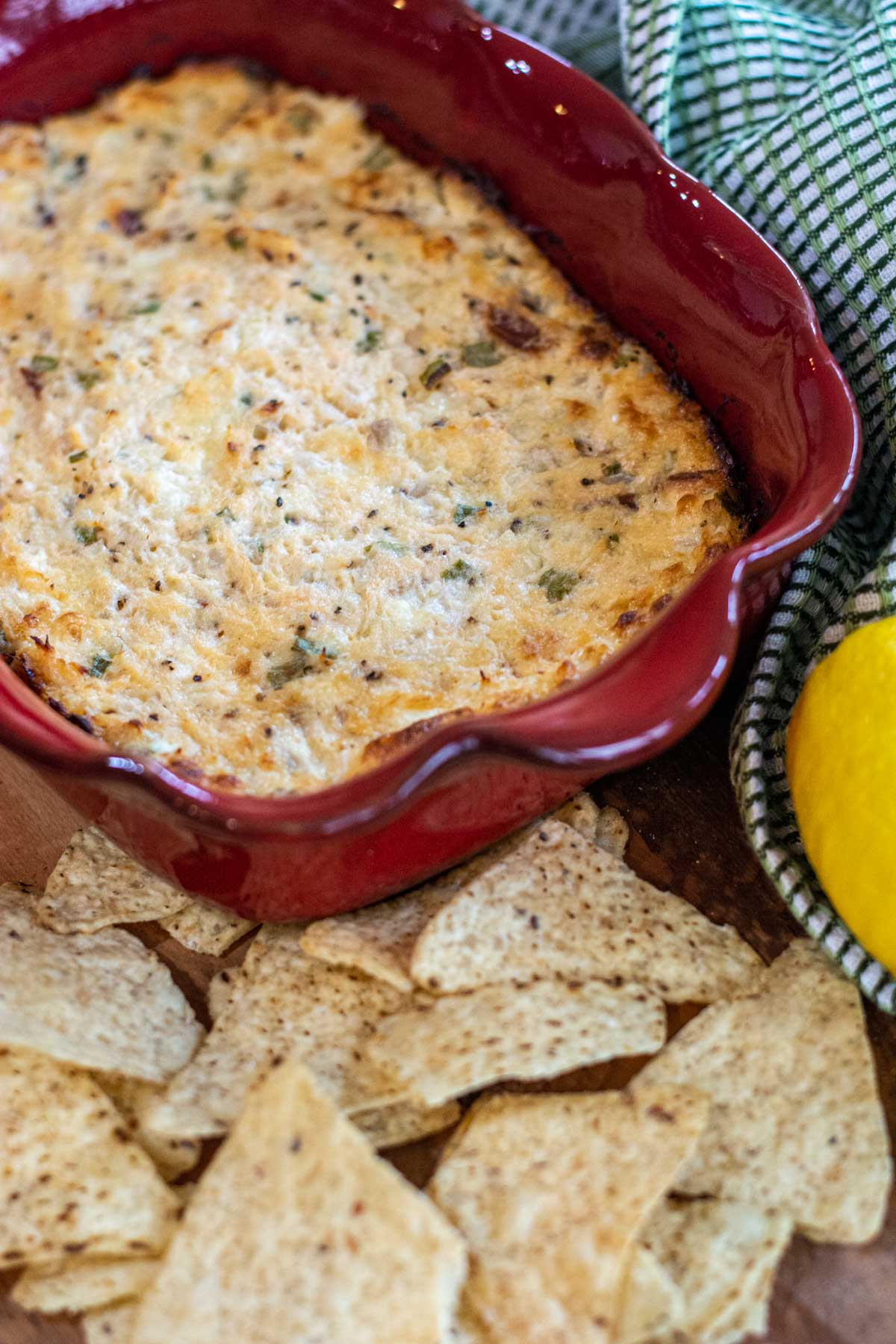 decorative dish with the smoked salmon dip and the counter has corn chips.