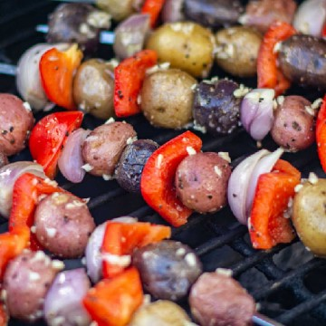 potatoes, shallots and red peppers on kabobs and coated with a garlic mixture on the grill.