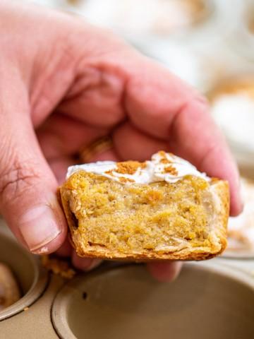 mini pumpkin pie bite cut in half above the muffin tin.