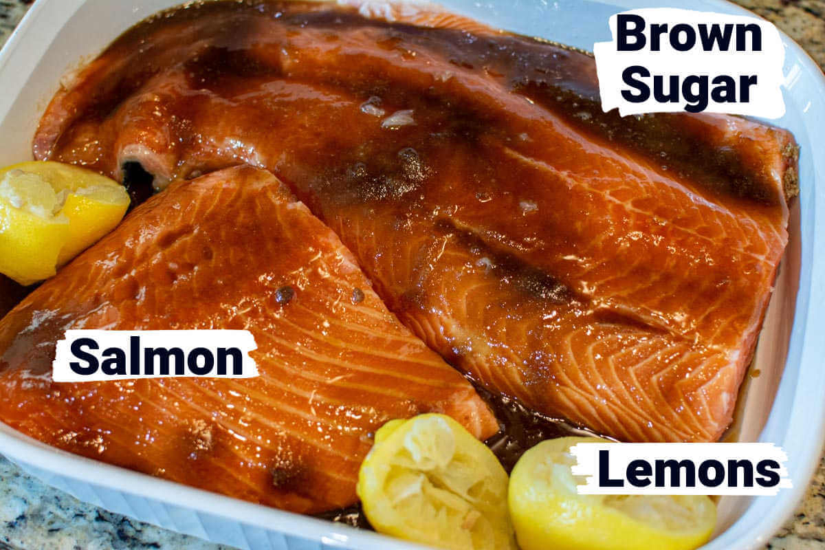 ingredient photo showing the salmon, lemons and brown sugar with labels.
