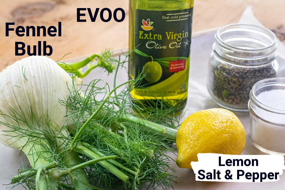 ingredient photo with labels showing the fennel bulb, olive oil, lemon, salt and pepper.