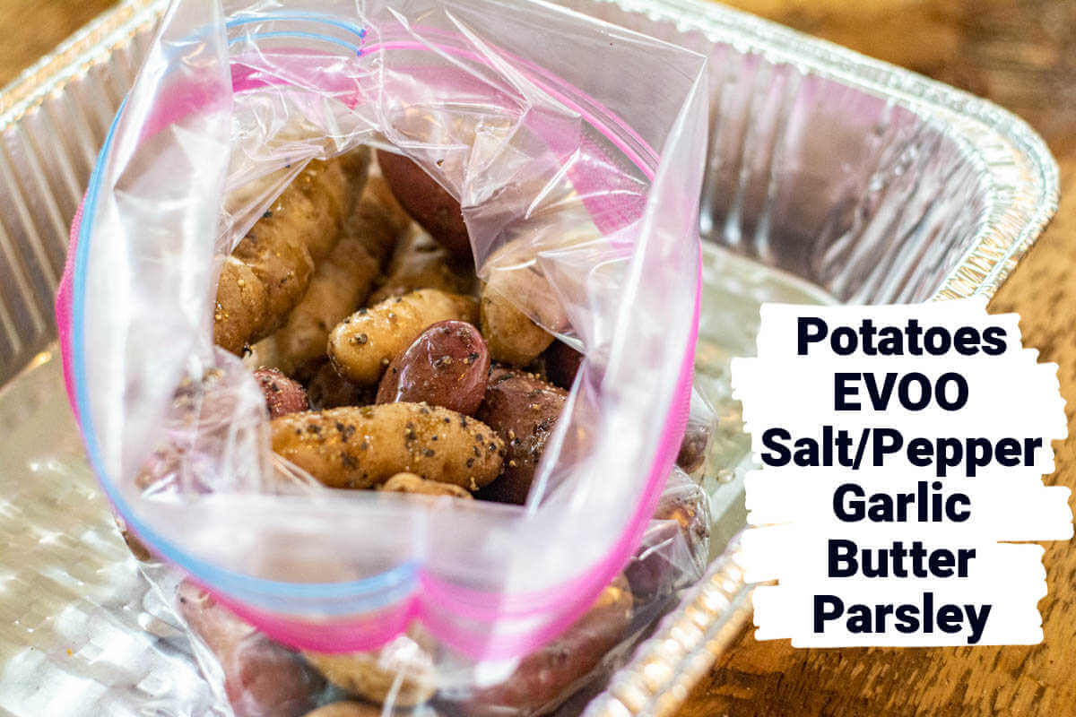 fingerlings potatoes in a Ziploc bag with olive oil, salt and pepper and a label showing all of the ingredients.