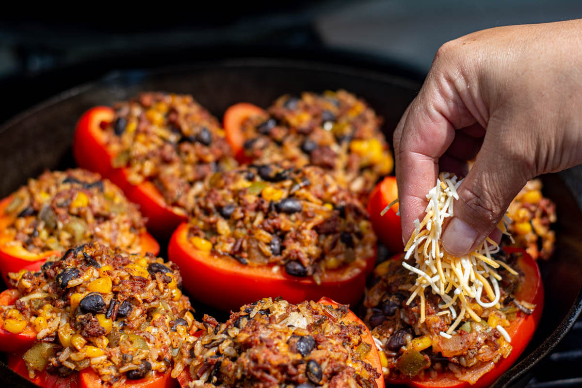sprinkling shredded cheese on the stuffed peppers towards the end of the grilling.