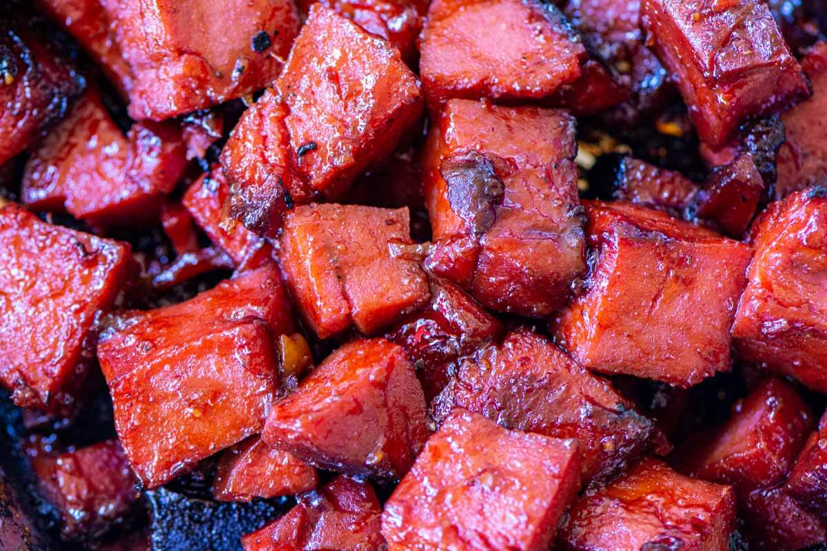 closeup of the thick and sticky sauce on the burnt ends.