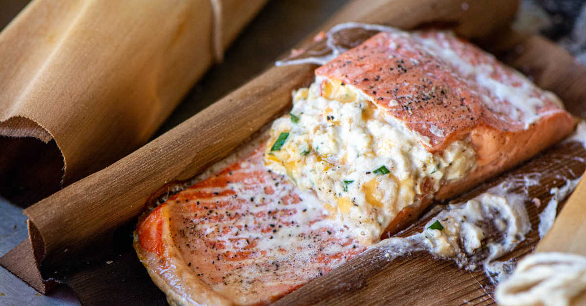 stuffed salmon removed from the grill and still inside the cedar wrapping.