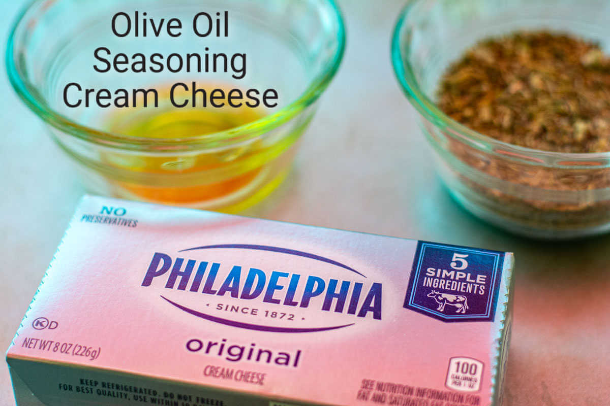 ingredient photo showing the block of Philadelphia Cream Cheese, olive oil, and seasoning with labels.