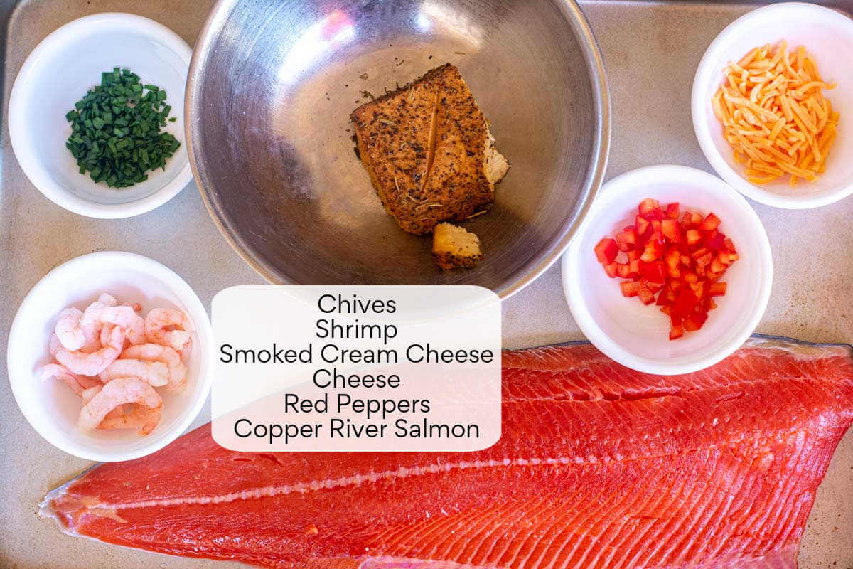 top down ingredient photo showing the salmon and all of the items for the stuffing.