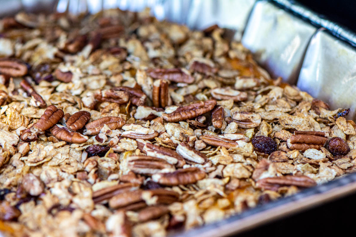 closeup of the casserole topped with whole grains, sweet dates, and chopped pecans.