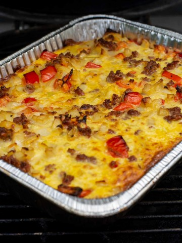 disposable aluminum pan on the grill with the breakfast casserole.