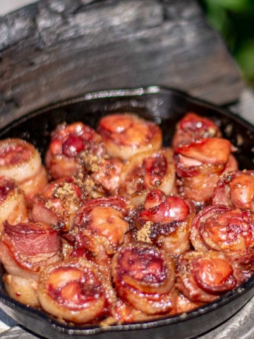bacon wrapped livers with brown sugar on the grilling table.
