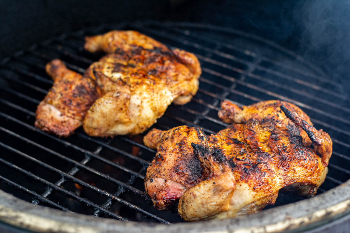 two cornish hens cut spatchcock style and grilled on the grating.